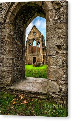 Valley Of The Cross Canvas Print by Adrian Evans