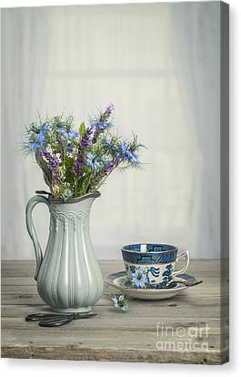 Vase Of Cornflowers Canvas Print by Amanda And Christopher Elwell