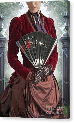 Victorian Woman In A Crimson Velvet Dress With Fan Canvas Print by Lee Avison