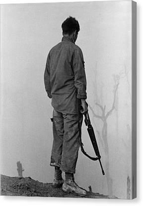 Vietnam War. Us Infantryman Looks Canvas Print by Everett