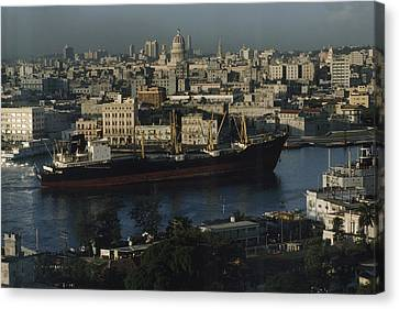 View Of City And A Massive Freighter Canvas Print by James L. Stanfield