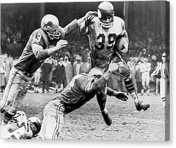 Viking Mcelhanny Gets Tackled Canvas Print by Underwood Archives