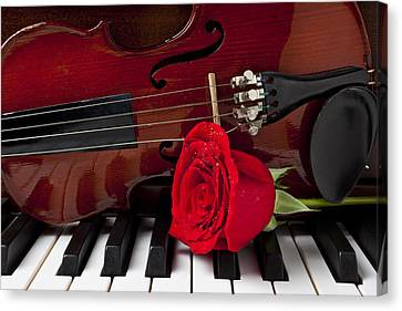 Violin And Rose On Piano Canvas Print by Garry Gay