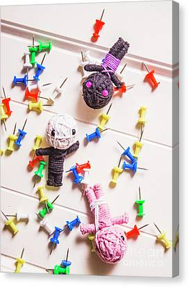 Voodoo Dolls Surrounded By Colorful Thumbtacks Canvas Print by Jorgo Photography - Wall Art Gallery