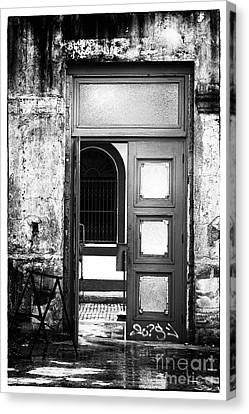 Waiting Past The Door Canvas Print by John Rizzuto