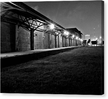 Warehouse At Night Canvas Print by John Collins