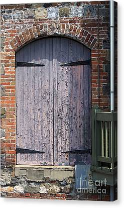 Warehouse Wooden Door Canvas Print by Thomas Marchessault