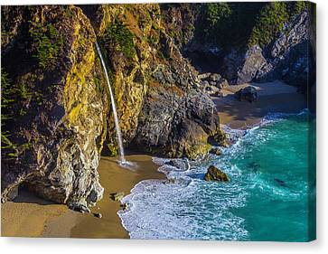 Waterfall Pouring Into The Ocean Canvas Print by Garry Gay