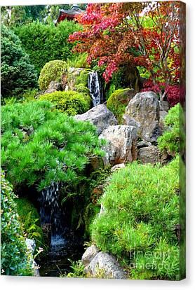 Waterfalls In Japanese Garden Canvas Print by Carol Groenen