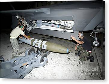 Weapons Loaders Load A Gbu-32 Jdam Canvas Print by HIGH-G Productions