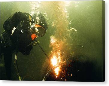 Welding Underwater Canvas Print by Peter Scoones
