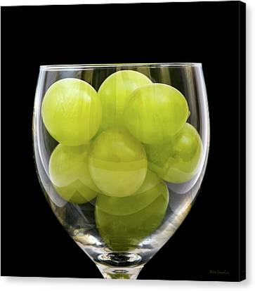White Grapes In Glass Canvas Print by Wim Lanclus