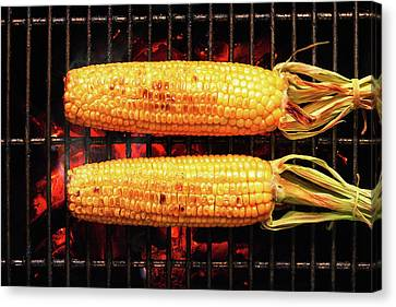 Whole Corn On Grill Canvas Print by Johan Swanepoel