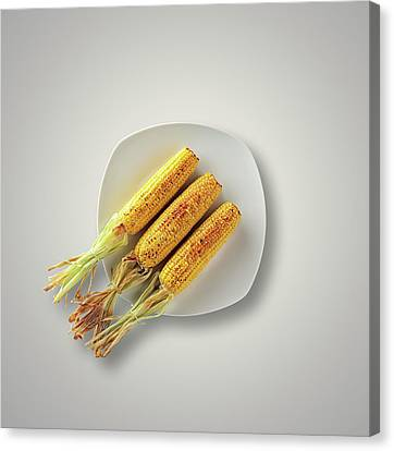 Whole Grilled Corn On A Plate Canvas Print by Johan Swanepoel