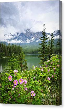 Wild Roses And Mountain Lake In Jasper National Park Canvas Print by Elena Elisseeva