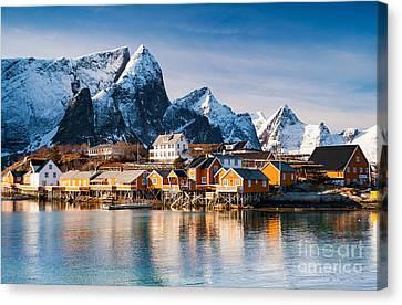Winter At Sakrisoy Village On The Lofoten Islands Canvas Print by Janet Burdon