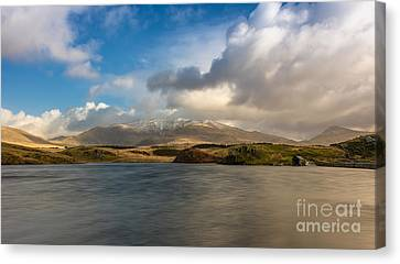 Winter Mountains Canvas Print by Adrian Evans