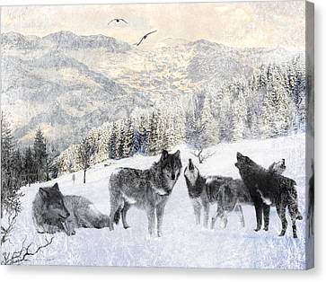Winter Wolves Canvas Print by Lourry Legarde