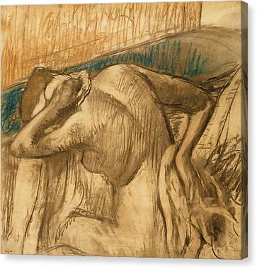 Woman At Her Toilet Canvas Print by Edgar Degas