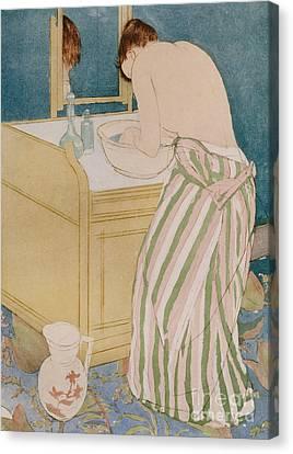Woman Bathing Canvas Print by Mary Stevenson Cassatt
