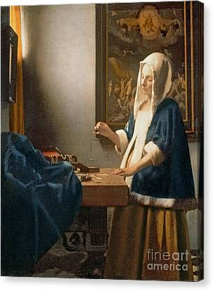 Woman Holding A Balance Canvas Print by Jan Vermeer
