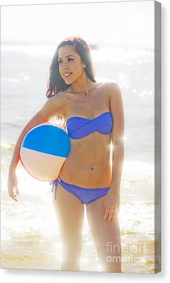 Woman Holding Beach Ball Canvas Print by Jorgo Photography - Wall Art Gallery