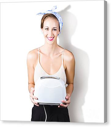 Woman Holding Toaster Canvas Print by Jorgo Photography - Wall Art Gallery