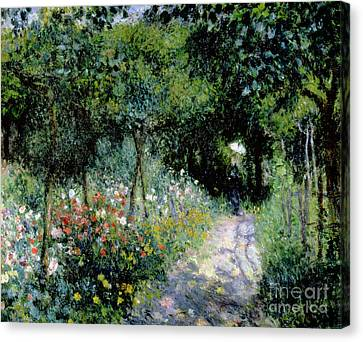 Woman In A Garden Canvas Print by Pierre Auguste Renoir