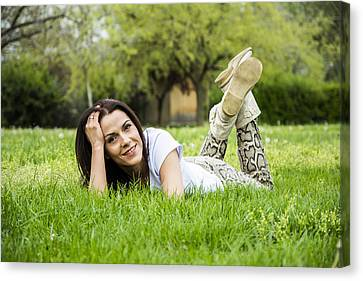 Woman Relaxing On The Grass In Springtime Canvas Print by Newnow Photography By Vera Cepic
