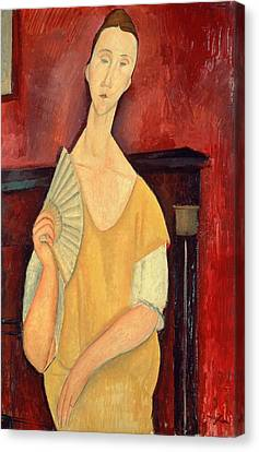Woman With A Fan Canvas Print by Amedeo Modigliani