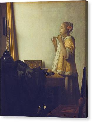 Woman With A Pearl Necklace Canvas Print by Jan Vermeer