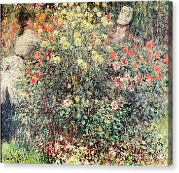 Women In The Flowers Canvas Print by Claude Monet