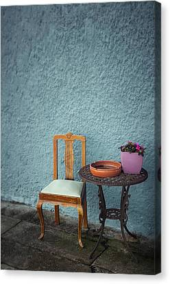 Wooden Chair And Iron Table Canvas Print by Carlos Caetano