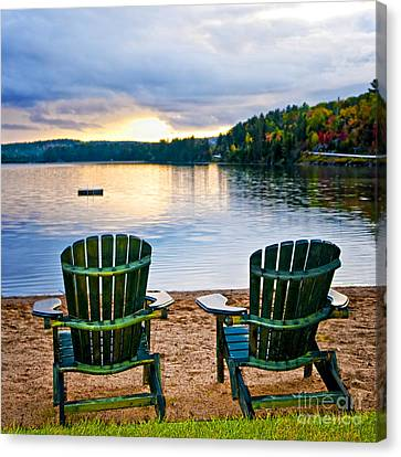 Wooden Chairs At Sunset On Beach Canvas Print by Elena Elisseeva