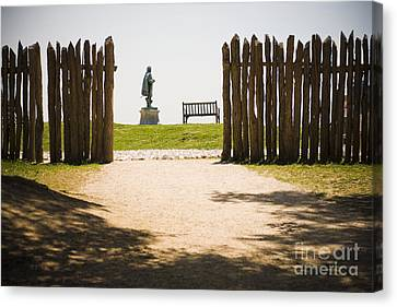 Wooden Fence And Statue Of John Smith Canvas Print by Roberto Westbrook