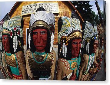 Wooden Indians Decorate A Store Front Canvas Print by Bill Hatcher