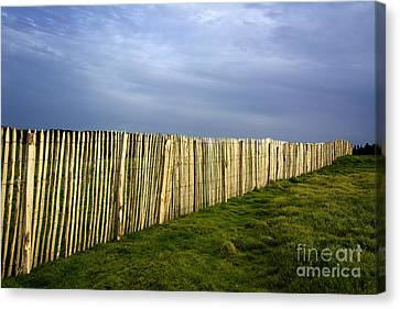Wooden Picket Fence. Auvergne. France. Canvas Print by Bernard Jaubert