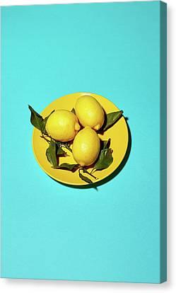 Yellow Lemons On Cyan Canvas Print by Oleg Cherneikin
