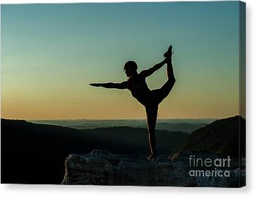 Yoga At Sunset Canvas Print by Dan Friend