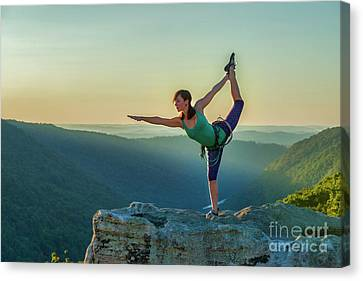 Yoga On The Mountain Tops Canvas Print by Dan Friend