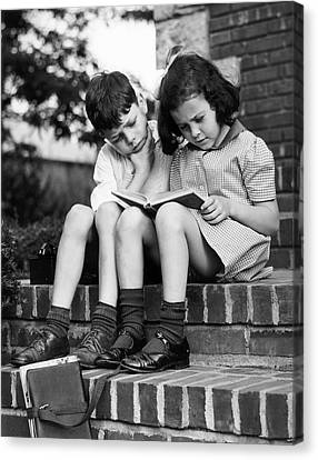 Young Boy & Girl Reading A Book Outdoors Canvas Print by George Marks