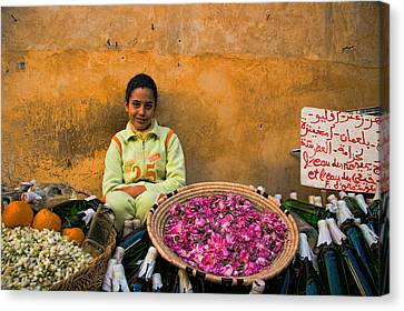 Young Girl Selling Rose Petals In The Medina Of Fes Morroco Canvas Print by David Smith