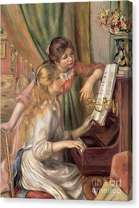 Young Girls At The Piano Canvas Print by Pierre Auguste Renoir