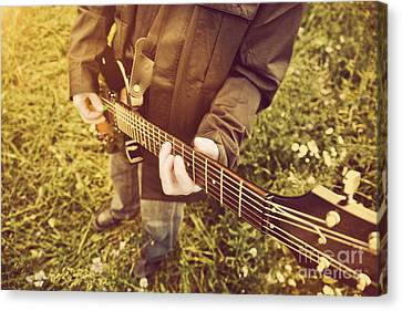 Young Man Playing On The Guitar Outdoors Canvas Print by Michal Bednarek