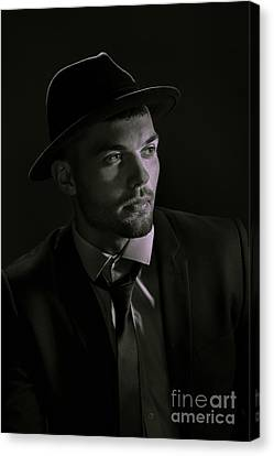Young Man Wearing Trilby Canvas Print by Amanda And Christopher Elwell