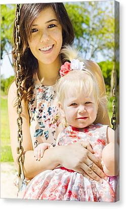 Young Mom With Her Baby Girl On A Swing Outside Canvas Print by Jorgo Photography - Wall Art Gallery