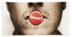 Face Of A Man With Beer Badge Hand Towel by Jorgo Photography - Wall Art Gallery