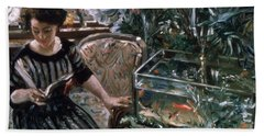 A Woman Reading Near A Goldfish Tank Hand Towel by Lovis Corinth