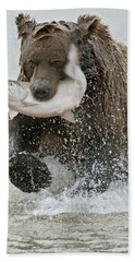 Brown Bear With Salmon Catch Hand Towel by Gary Langley