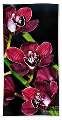 Cascading Red Orchids Hand Towel by Kaye Menner